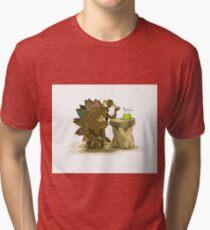 Illustration of a Stegosaurus drinking a beverage. Tri-blend T-Shirt