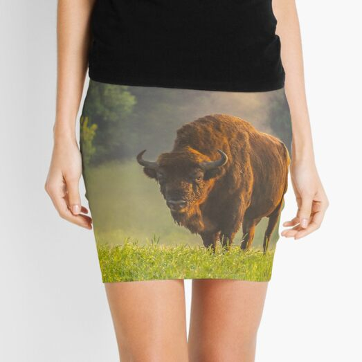 Wisent or european bison steaming in the morning light Mini Skirt