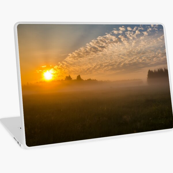 Meteor like sunrise near old forest Laptop Skin