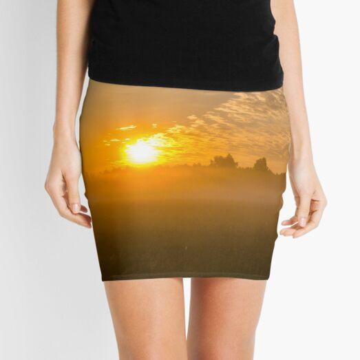 Meteor like sunrise near old forest Mini Skirt