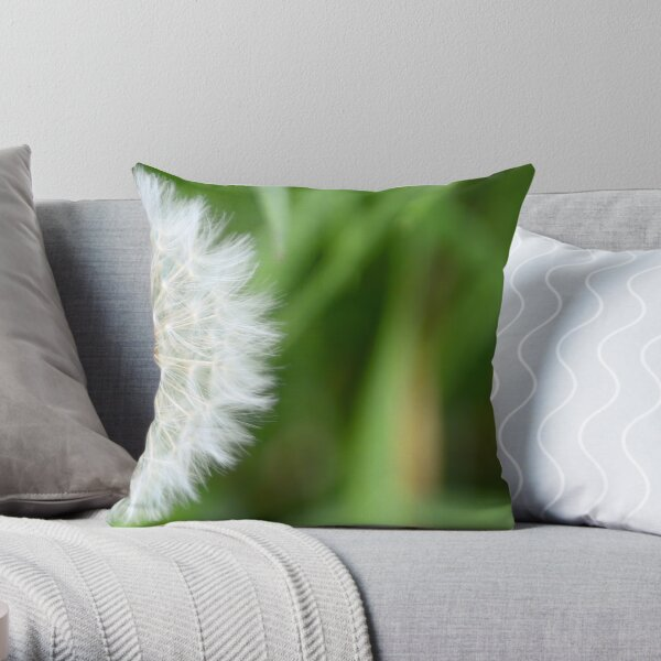 Beautiful full blown white dandelion against a natural green background, to make a wish with Throw Pillow