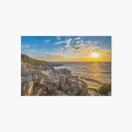 Stunning sunset over ocean and cliffs Art Board Print