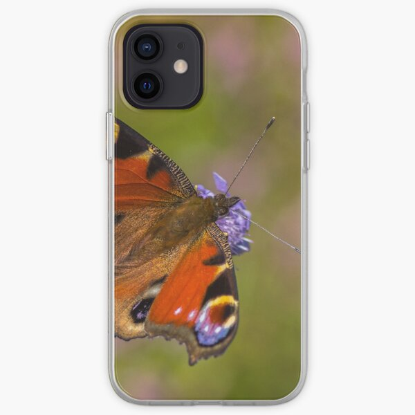 The European peacock has great fake eyes on the wings iPhone Soft Case