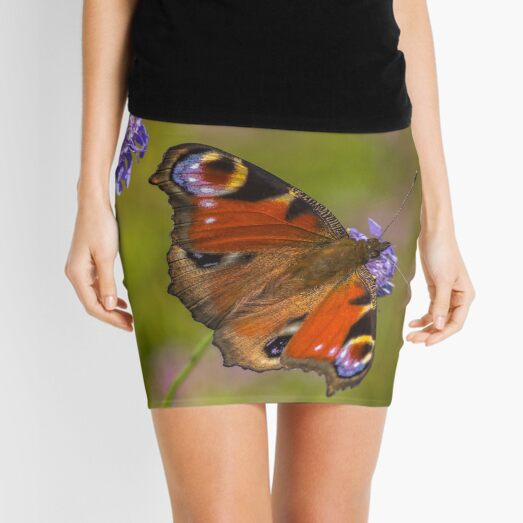 The European peacock has great fake eyes on the wings Mini Skirt