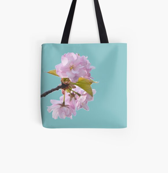 Beautiful pink cherry blossom in full bloom with turquoise blue background - the power of flowers. All Over Print Tote Bag