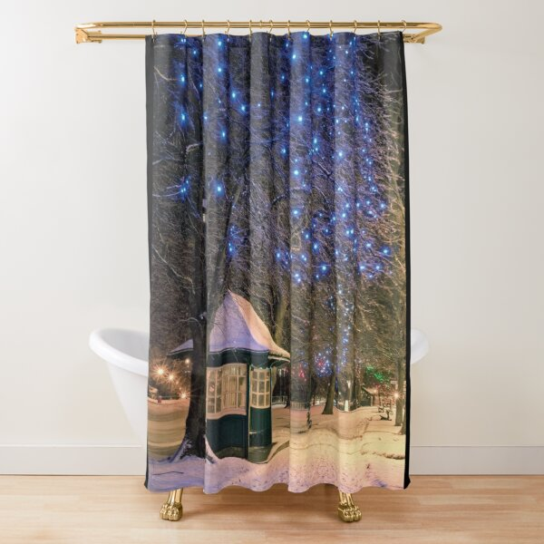 Snow covered west park blue lights Shower Curtain