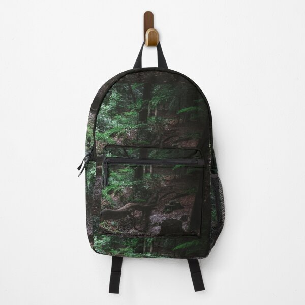 Deep in the woods lies a fallen tree Backpack