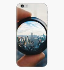 Man holding a lens over Manhattan iPhone Case