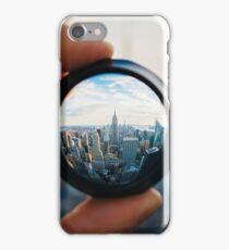 Man holding a lens over Manhattan iPhone Case/Skin