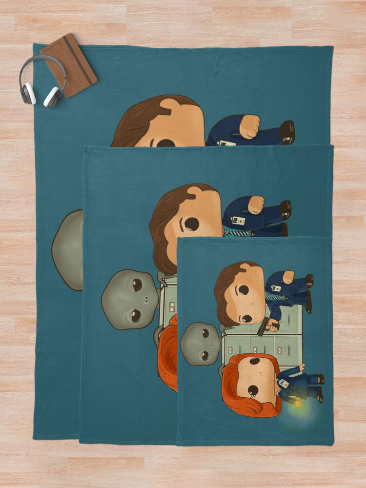 Alternate view of Funko pop doll of Fox Mulder  and Dana Scully Throw Blanket
