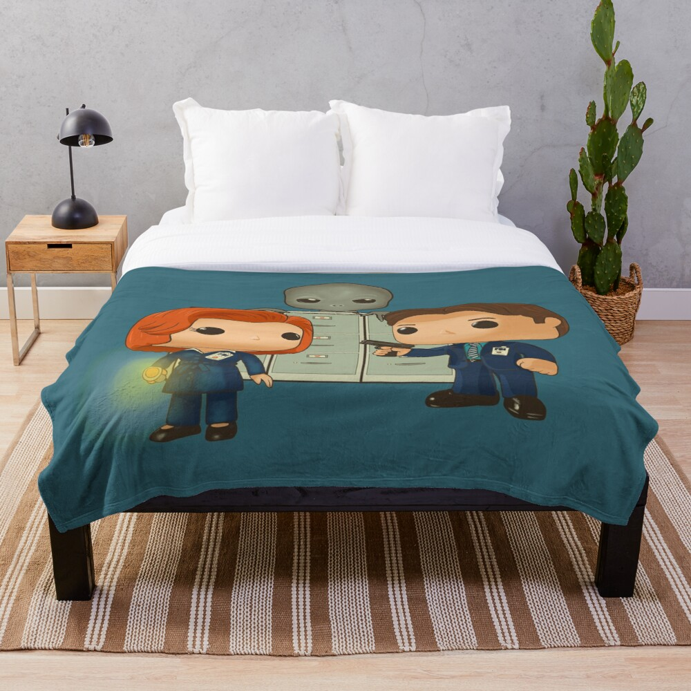 Funko pop doll of Fox Mulder  and Dana Scully Throw Blanket