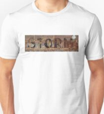 Word Storm with vintage writing on brick wall  T-Shirt