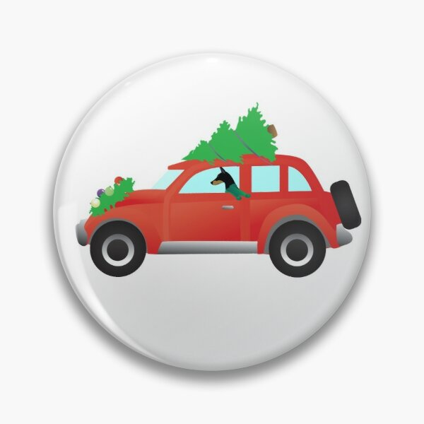 Doberman Pinscher Driving a Red Car with a Christmas Tree on Top Pin