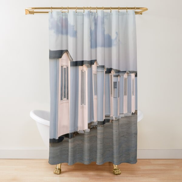 White beach huts on the golden sand at sun set Shower Curtain