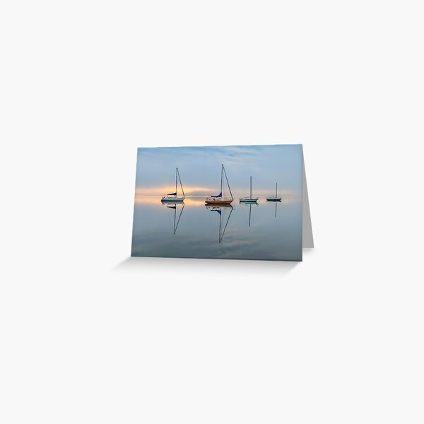Clouds, boats and reflections on a foggy morning Greeting Card