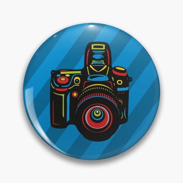Black Camera on blue background Pin