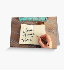 Motivational concept with handwritten text LOVE ALWAYS WINS Greeting Card