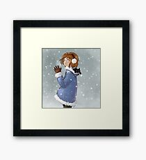 Playing together in the snow Framed Print