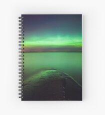 Northern lights glow over lake Spiral Notebook