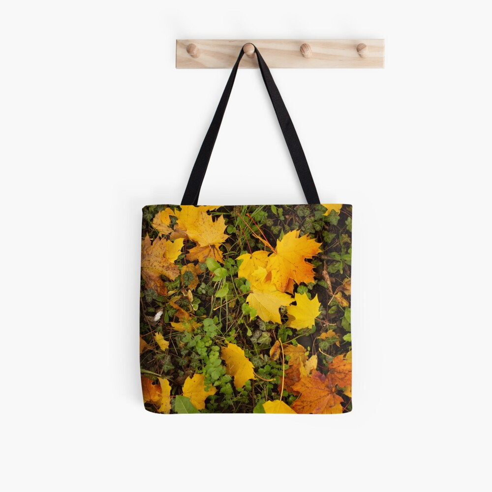 Autumn leaves in oranges and reds and greens. Fall colors Tote Bag