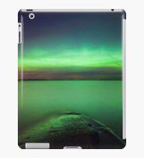 Northern lights glow over lake iPad Case/Skin