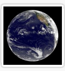 View of Earth showing three tropical cyclones in the Pacific Ocean. Sticker