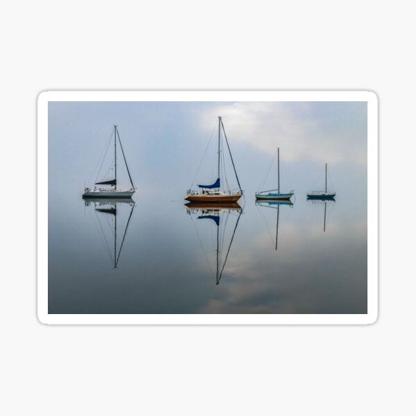 Clouds, boats and reflections on a misty morning Sticker
