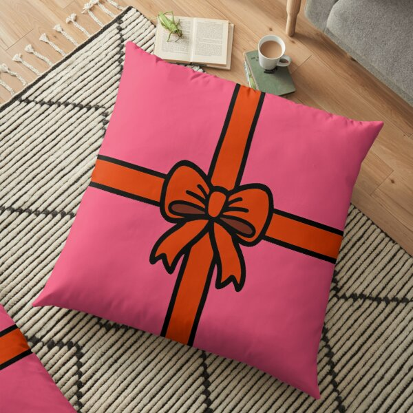 Festive Red Gift Bow on Pink Floor Pillow