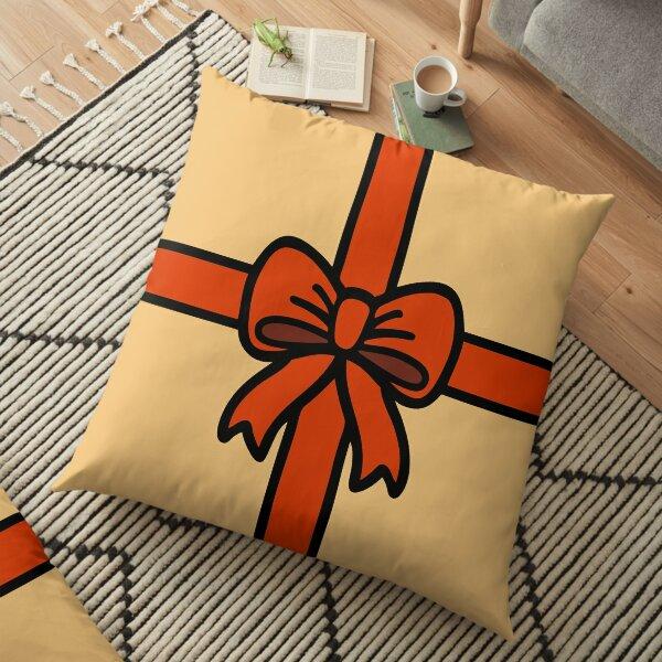 Festive Red Gift Bow on Gold Floor Pillow