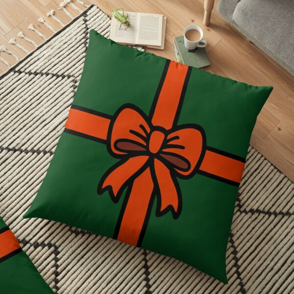 Festive Red Gift Bow on Green Floor Pillow
