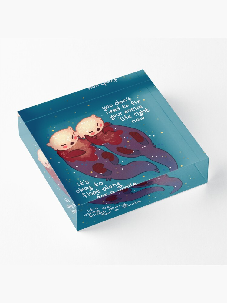 "Alternate view of ""It's Okay to Float Along For a While"" Hand Holding Otters Acrylic Block"