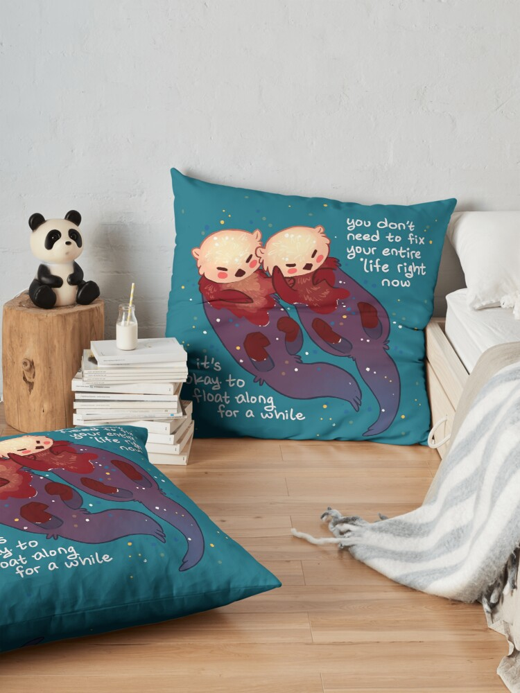"Alternate view of ""It's Okay to Float Along For a While"" Hand Holding Otters Floor Pillow"
