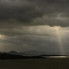 A finger of light from the heavens finds Lago Trasimeno, Umbria, Italy by Andrew Jones