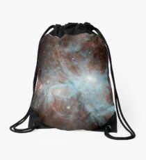 A colony of hot young stars in the Orion Nebula. Drawstring Bag