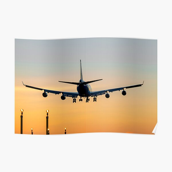 Aircraft Landing at Sunset Poster