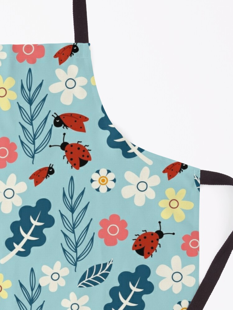Alternate view of Spring meadow in bloom with ladybirds on blue background Apron