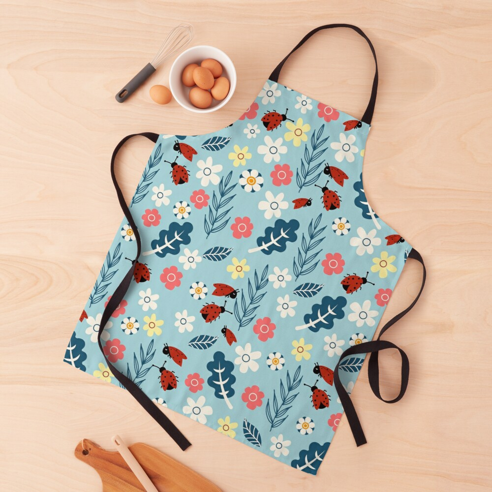 Spring meadow in bloom with ladybirds on blue background Apron