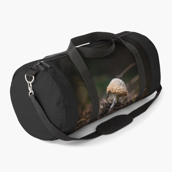 Mushroom sitting alone in the forest bed Duffle Bag