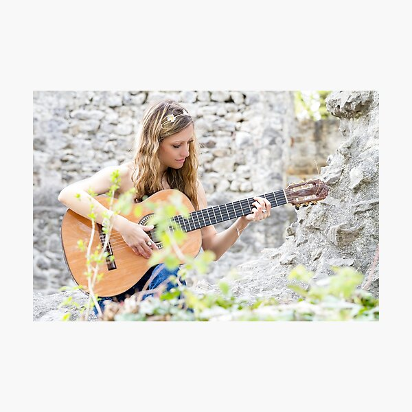 Guitarist playing on a ruined castle Photographic Print