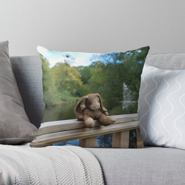 Little bear soft toy sitting on the fence Throw Pillow
