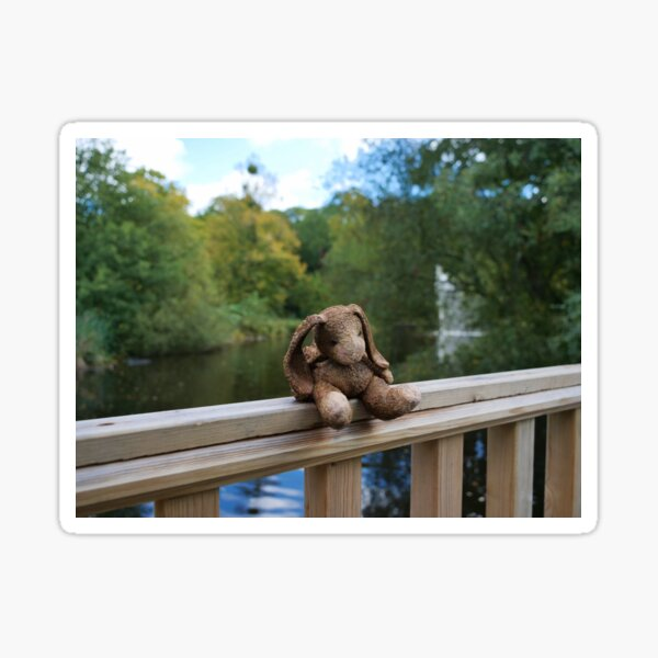 Little bear soft toy sitting on the fence Sticker