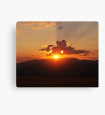 Sunset over mountains Canvas Print