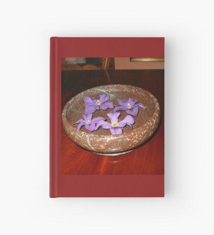 Die Schwimmer - purpurrote Clematis-Blüten Notizbuch