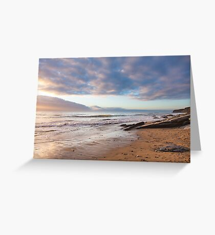 Golden light and fluffy clouds at Watergate Bay, Cornwall, UK Greeting Card