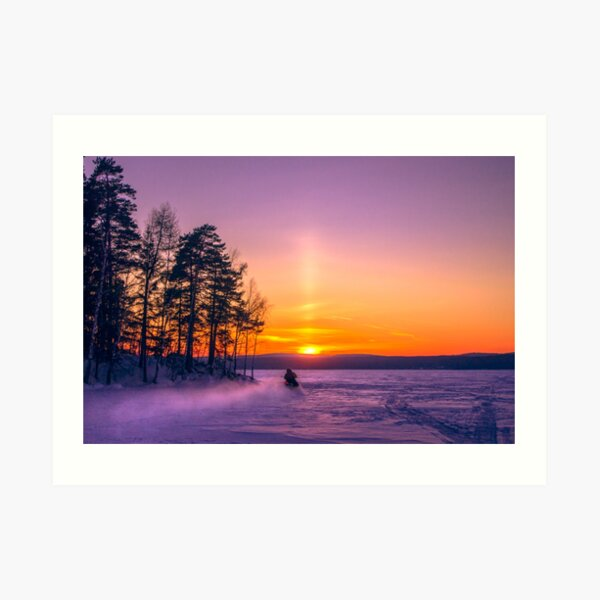 The snow mobile race toward the Sun pillar Art Print