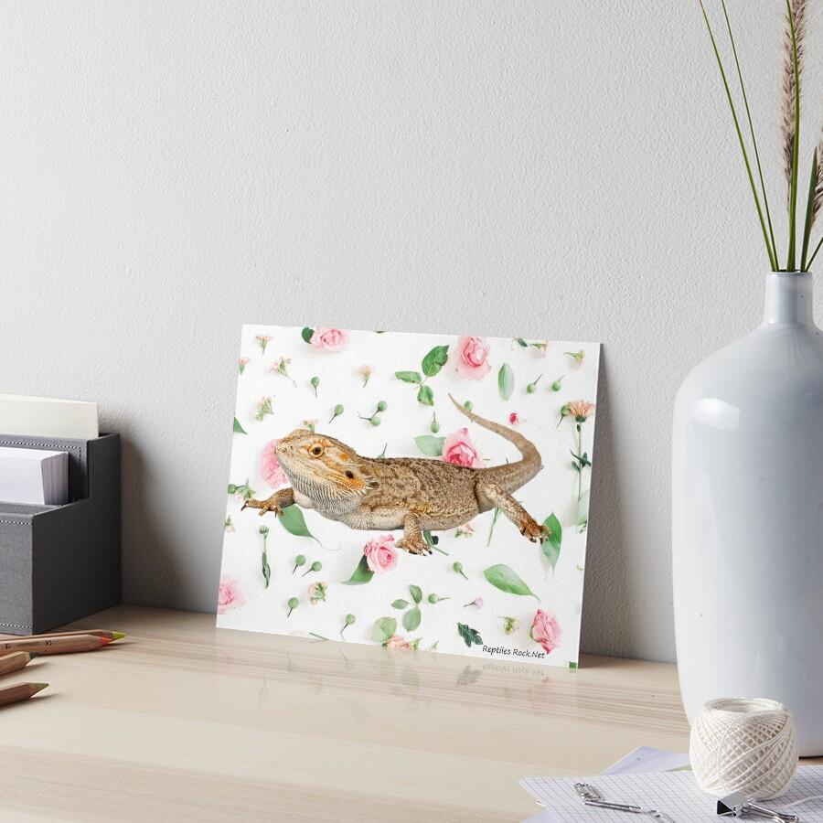 Bearded Dragon On A Carnation Background Art Board Print