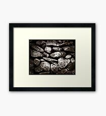 Rocked Wall Framed Print