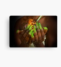 African model with a ball of fire in her hands.  Canvas Print