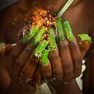 African model with a ball of fire in her hands.  by PhotoStock-Isra