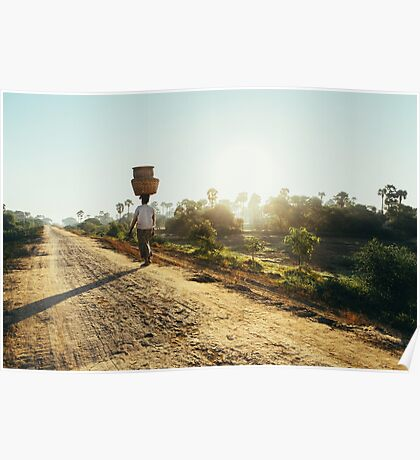 Woman Carrying Baskets on Head Walking in Burmese Countryside in Early Morning Poster